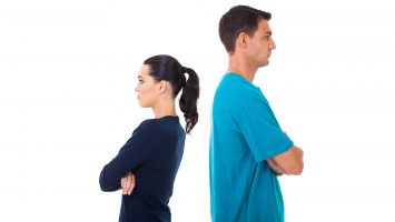 young couple having argument and turning their back on each other