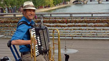 Paris France - July 26 2013: One Man Band Entertains tourists on the Pont Des Arts bridge Paris France.