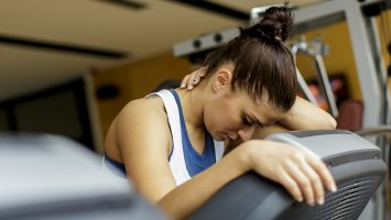 Pretty young woman training at the gym