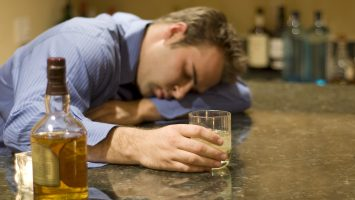 young man passed out from drinking alcohol